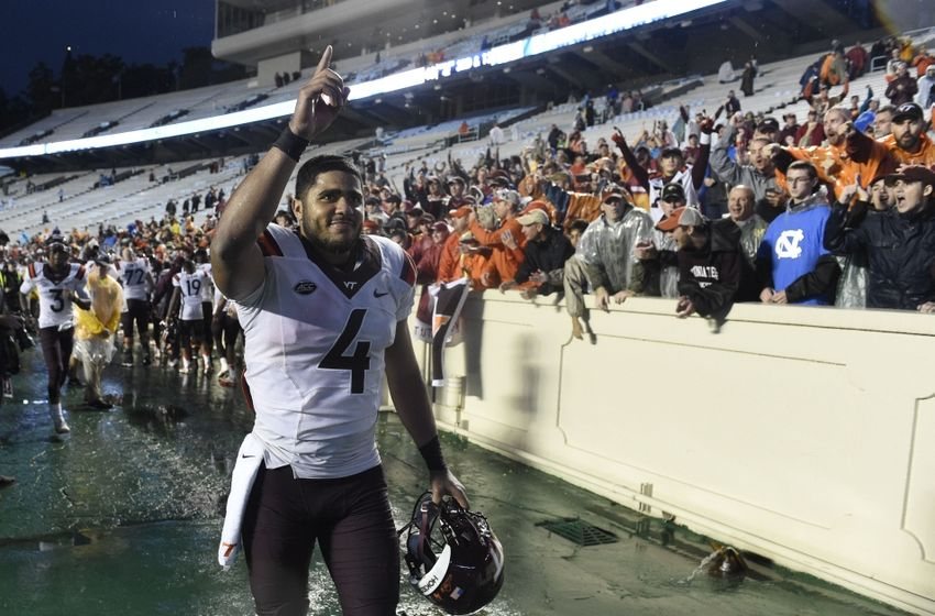 Oct 8, 2016; Chapel Hill, NC, USA; Virginia Tech Hokies quarterback Jerod Evans (4) celebrates after the game. The Hokies defeated the Tar Heels 34-3 at Kenan Memorial Stadium. Mandatory Credit: Bob Donnan-USA TODAY Sports