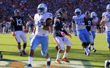 Oct 22, 2016; Charlottesville, VA, USA; North Carolina Tar Heels running back Elijah Hood (34) carries the ball for a touchdown against the Virginia Cavaliers in the first quarter at Scott Stadium. Mandatory Credit: Amber Searls-USA TODAY Sports
