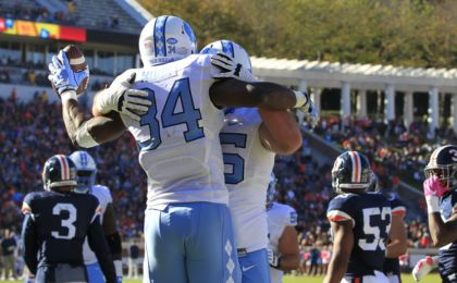 Oct 22, 2016; Charlottesville, VA, USA; North Carolina Tar Heels running back Elijah Hood (34) celebrates with Tar Heels offensive tackle Bentley Spain (75) after scoring a touchdown against the Virginia Cavaliers in the first quarter at Scott Stadium. Mandatory Credit: Amber Searls-USA TODAY Sports