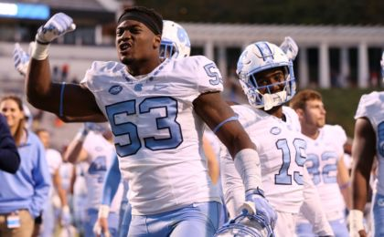 Oct 22, 2016; Charlottesville, VA, USA; North Carolina Tar Heels defensive end Malik Carney (53) celebrates with teammates after their game against the Virginia Cavaliers at Scott Stadium. The Tar Heels won 35-14. Mandatory Credit: Amber Searls-USA TODAY Sports