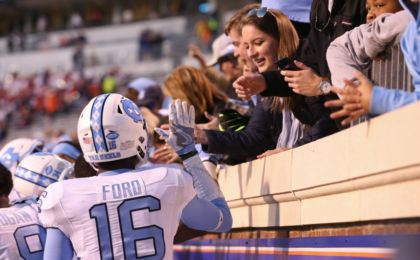 Oct 22, 2016; Charlottesville, VA, USA; North Carolina Tar Heels defensive back D.J. Ford (16) celebrates with fans after the Tar Heels game against the Virginia Cavaliers at Scott Stadium. The Tar Heels won 35-14. Mandatory Credit: Amber Searls-USA TODAY Sports