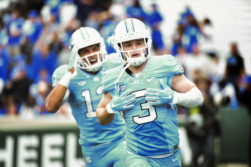 Nov 7, 2015; Chapel Hill, NC, USA; North Carolina Tar Heels wide receiver Ryan Switzer (3) reacts in the end zone with wide receiver Mack Hollins (13) after scoring a touchdown in the first quarter at Kenan Memorial Stadium. Mandatory Credit: Bob Donnan-USA TODAY Sports