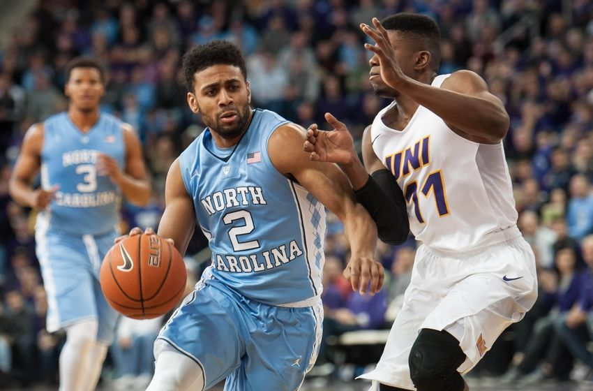 Nov 21, 2015; Cedar Falls, IA, USA; North Carolina Tar Heels guard Joel Berry II (2) is defended by Northern Iowa Panthers guard Wes Washpun (11) during the second half at McLeod Center. Northern Iowa won 71-67. Mandatory Credit: Jeffrey Becker-USA TODAY Sports