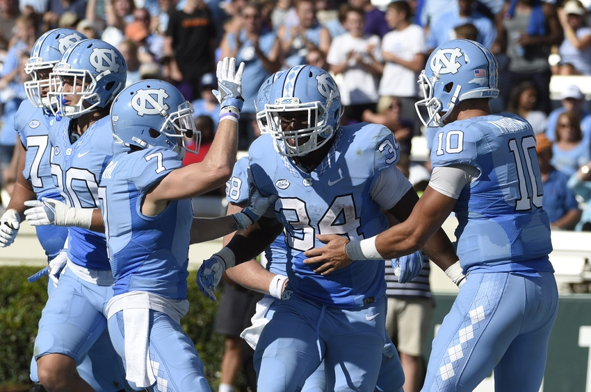 Sep 17, 2016; Chapel Hill, NC, USA; North Carolina Tar Heels running back Elijah Hood (34) celebrates after scoring a touchdown with wide receiver Austin Proehl (7) and quarterback Mitch Trubisky (10) at Kenan Memorial Stadium. The Tar Heels defeated the James Madison Dukes 56-28. Mandatory Credit: Bob Donnan-USA TODAY Sports