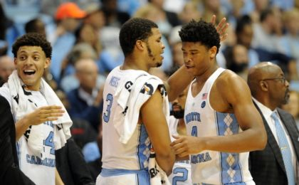 Nov 15, 2016; Chapel Hill, NC, USA; North Carolina Tar Heels forward Justin Jackson (44) and forward Kennedy Meeks (3) and forward Isaiah Hicks (4) celebrate in game against Long Beach State 49ers during the second half at Dean E. Smith Center. North Carolina won 93-67. Mandatory Credit: Evan Pike-USA TODAY Sports