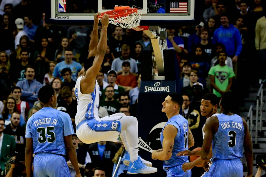 Nov 11, 2016; New Orleans, LA, USA; North Carolina Tar Heels guard Brandon Robinson (14) dunks over Tulane Green Wave guard Melvin Frazier (35) and forward Sammis Reyes (12) during the first quarter of a game at the Smoothie King Center. Mandatory Credit: Derick E. Hingle-USA TODAY Sports