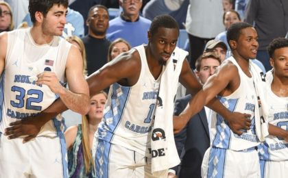 Jan 8, 2017; Chapel Hill, NC, USA; North Carolina Tar Heels forwards Luke Maye (32) and Theo Pinson (1) and guard Kenny Williams (24) on the bench in the second half. The Tar Heels defeated the Wolfpack 107-56 at Dean E. Smith Center. Mandatory Credit: Bob Donnan-USA TODAY Sports