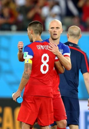 Jun 16, 2014; Natal, BRAZIL; USA forward Michael Bradley (right) celebrates with Clint Dempsey following the game against Ghana during the 2014 World Cup at Estadio das Dunas. USA defeated Ghana 2-1. Mandatory Credit: Mark J. Rebilas-USA TODAY Sports