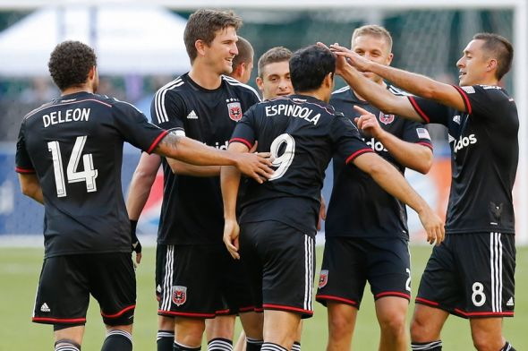 May 31, 2014; Washington, DC, USA; D.C. United forward Fabian Espindola (9) celebrates with teammates after scoring a goal against Sporting KC at Robert F. Kennedy Memorial Stadium. Mandatory Credit: Geoff Burke-USA TODAY Sports