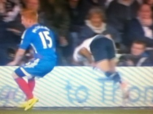 Andros Townsend Fall Over the hoardings. [Photo: Alan Hill]