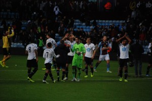Hugo Lloris and the team celebrate another win at Villa [Photo: Jav The_DoC_66]