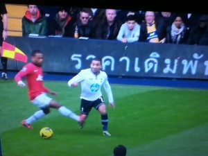 Aaron Lennon was a constant threat to Evra who found his own way to deal with him. [Photo: Alan Hill]