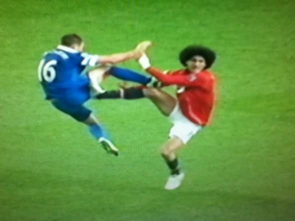 Fellaini 'tackle' [Photo: Alan Hill]