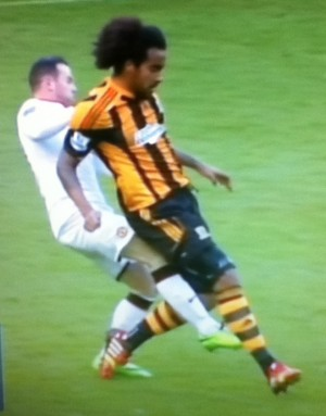 Rooney on Tom Huddlestone [Photo: Alan Hill]