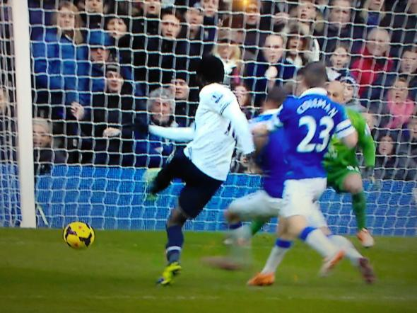 Emmanuel Adebayor scores against Everton [Photo: Alan Hill]