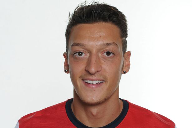 Mesut Ozil in an Arsenal shirt. Pic: Daily Mirror.