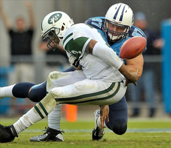 Sep 29, 2013; Nashville, TN, USA; Tennessee Titans defensive tackle Karl Klug (97) sacks New York Jets quarterback Geno Smith (7) forcing a fumble that is returned for a touchdown during the second half at LP Field. Tennessee won 38-13. Mandatory Credit: Jim Brown-USA TODAY Sports