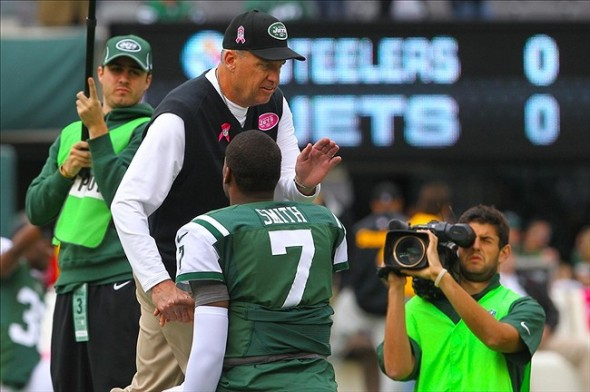 Oct 13, 2013; East Rutherford, NJ, USA; New York Jets head coach Rex Ryan and New York Jets quarterback Geno Smith (7) shake hands during the pre game warmups for their game against the Pittsburgh Steelers at MetLife Stadium. Mandatory Credit: Ed Mulholland-USA TODAY Sports