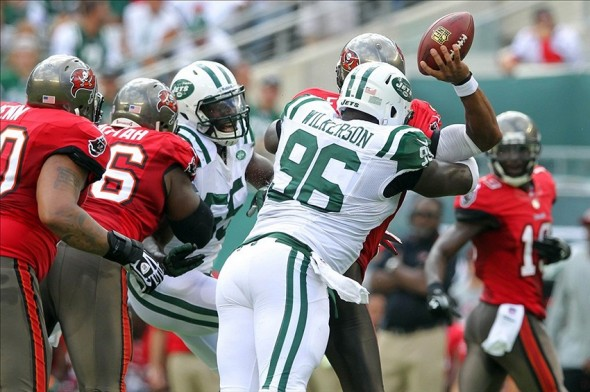 Sep 8, 2013; East Rutherford, NJ, USA; Tampa Bay Buccaneers quarterback Josh Freeman (5) is sacked by New York Jets defensive end Muhammad Wilkerson (96) during the first quarter of a game at MetLife Stadium. Mandatory Credit: Brad Penner-USA TODAY Sports