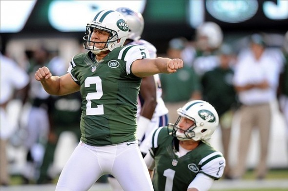 Oct 20, 2013; East Rutherford, NJ, USA; New York Jets kicker Nick Folk (2) celebrates his game winning field goal during overtime against the New England Patriots at MetLife Stadium. The Jets won the game 30-27 in overtime. Mandatory Credit: Joe Camporeale-USA TODAY Sports