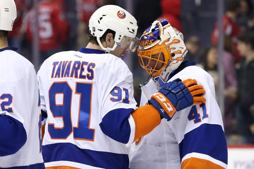 9716327-john-tavares-jaroslav-halak-nhl-new-york-islanders-washington-capitals