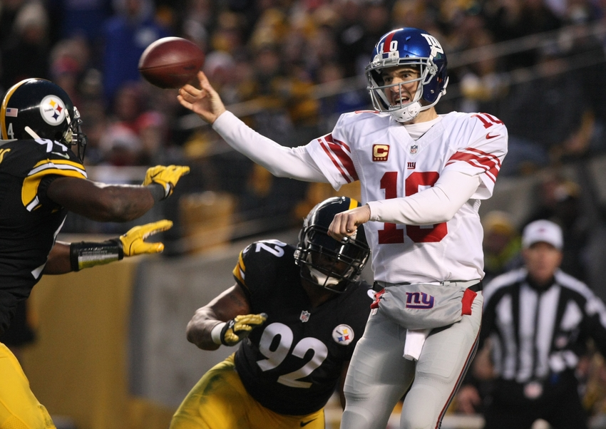9725517-james-harrison-eli-manning-lawrence-timmons-nfl-new-york-giants-pittsburgh-steelers