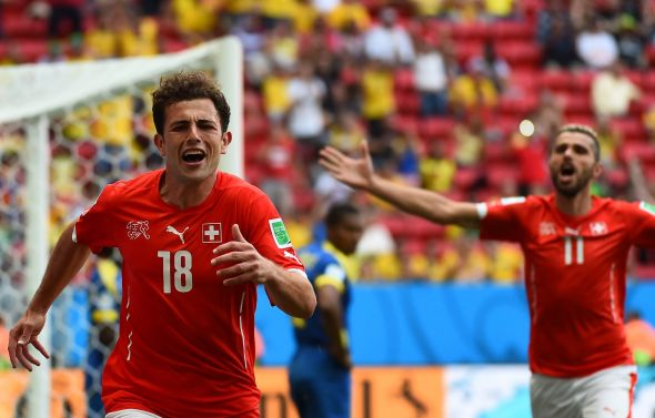 Admir Mehmedi (left) scored the late winner against Ecuador in the first match for Switzerland, but can he summon another magical moment when his country need him most?