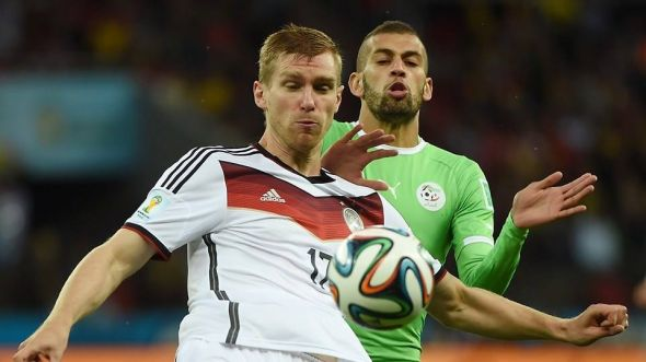Per Mertesacker (left) and the rest of the German defense were pinned back and under siege for the majority of the first half - a fact that surprised nearly everyone.