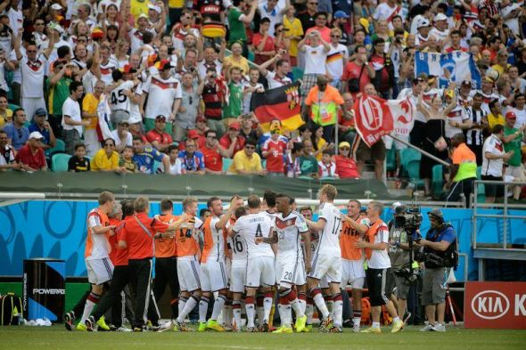 Muller and company celebrate his hat-trick. The Golden Boot winner in 2010, he looks the part again.