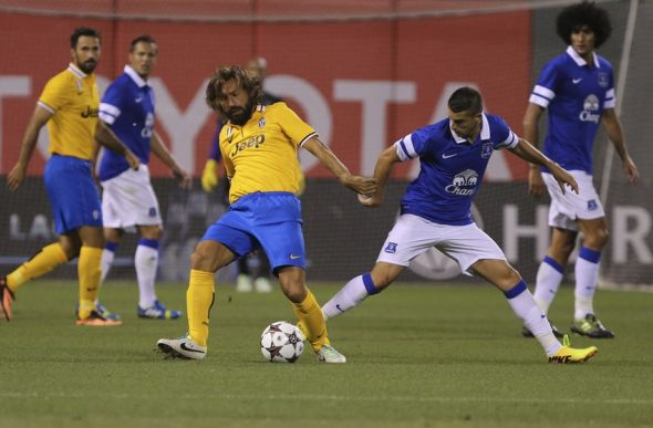 Andrea Pirlo (in yellow) must dictate the match on Italy's terms. A good peformance from him gives them that added chance of winning. Mandatory Credit: Kelley L Cox-USA TODAY Sports