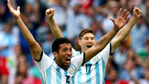 Ezequiel Garay and Federico Fernandez (left to right) will be hoping to lead the celebrations for Argentina as they hope to storm into the quarterfinals
