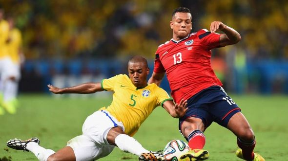 Fernandinho and Freddy Guarin battle in midfield - the match would be littered with physical play from start to finish