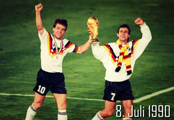 Lothar Matthaus and Pierre Littbarski lift the World Cup in Germany's win in 1990