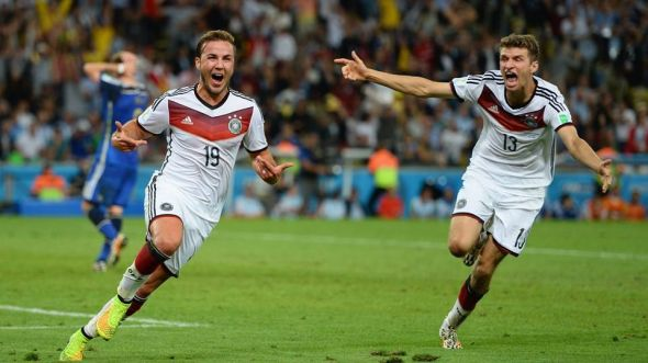 Mario Gotze celebrates his winner in the 113th with friend Thomas Muller