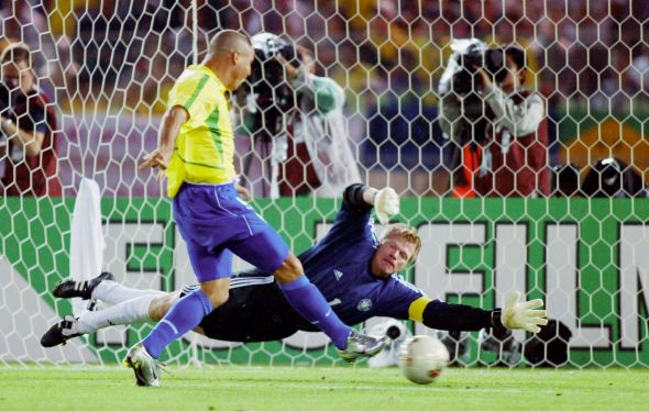 """Il Fenomeno"" (Ronaldo) slots past the great Oliver Kahn in Brazil's victory over the European giants in the 2002 World Cup final"