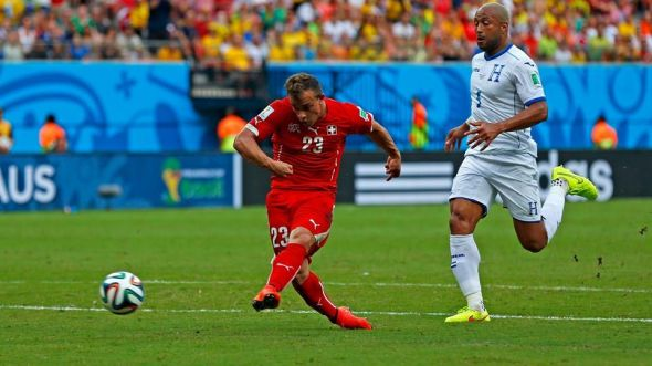 Xherdan Shaqiri (in red) has been immense for Switzerland, capping off the group stage with a historic hat-trick for his country.