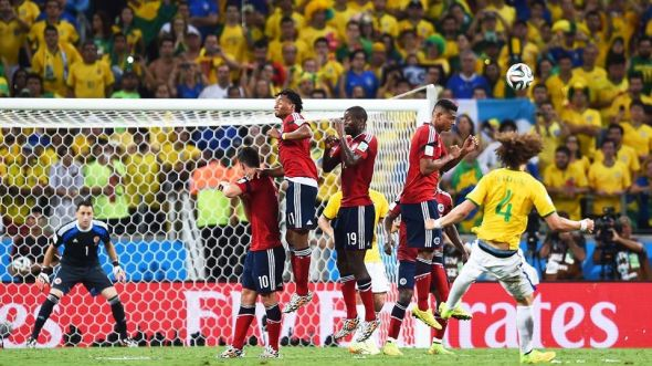 David Luiz sends his brilliantly struck free-kick past David Ospina to put Brazil two to the good