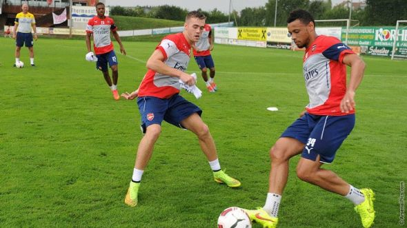 Calum Chambers (left) seen here in training against Francis Coquelin, could well be the only first-team center back available for selection against Crystal Palace next weekend
