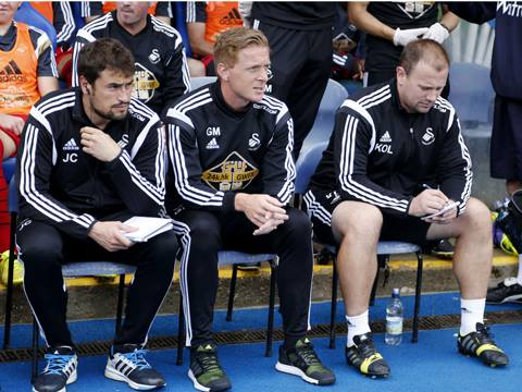 Gary Monk (center) looks on as Swansea win 3-1 against Reading. His first full season at the helm of the south Wales club could be an exciting one, given their activity in the transfer window.