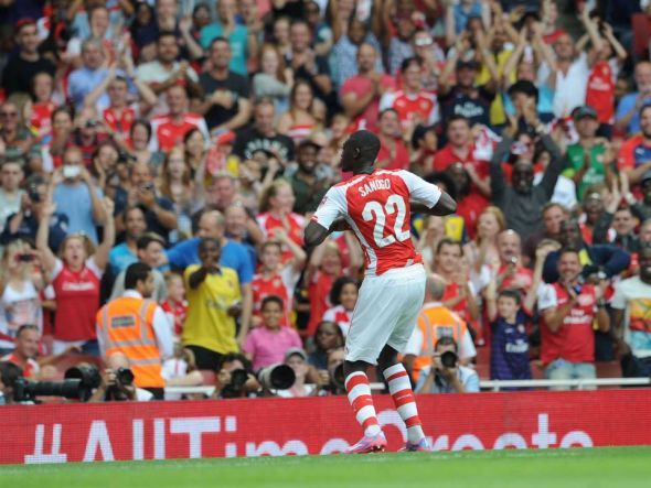 Yaya Sanogo celebrates one of his four goals in Arsenal's 5-1 rout of Benfica at the Emirates