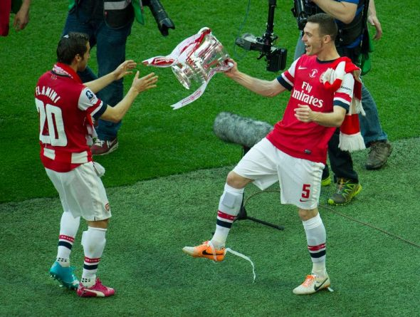 Thomas Vermaelen's last major action for the club saw him help his side to FA Cup glory in May - his departure leaves Arsene Wenger well short of options in the center of defense