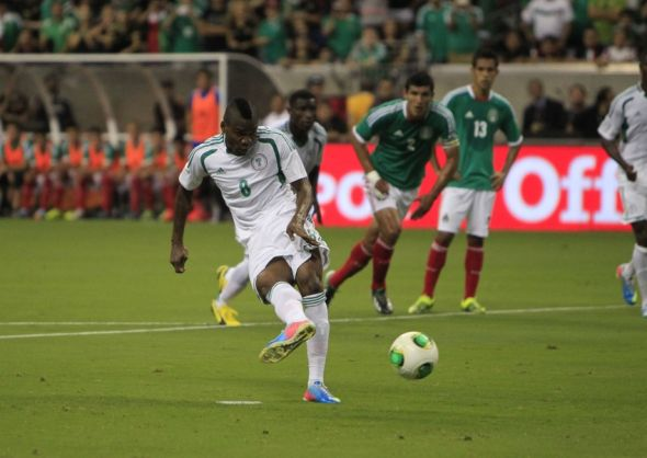 May 31, 2013; Houston, TX, USA; Nigeria forward Aide Brown Ideye (8) scores on a penalty kick against Mexico during the first half at Reliant Stadium. Mandatory Credit: Thomas Campbell-USA TODAY Sports