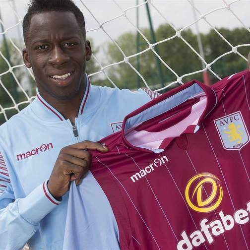 New signing Aly Cissokho posing with his new shirt - Taken from Aston Villa official Facebook page
