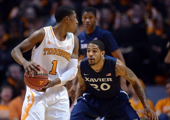 Dec 29, 2012; Knoxville, TN, USA; Tennessee Volunteers guard Josh Richardson (1) is defended by Xavier Musketeers forward Justin Martin (20) during the second half at Thompson-Boling Arena. Tennessee won 51 to 47. Mandatory Credit: Randy Sartin-USA TODAY Sports