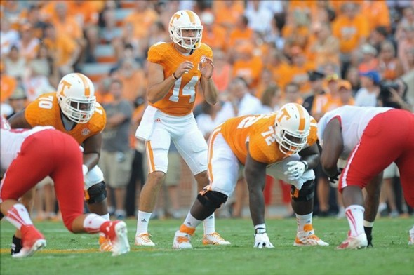 Aug 31, 2013; Knoxville, TN, USA; Tennessee Volunteers quarterback Justin Worley (14) gets ready for the snap against the Austin Peay Governors at Neyland Stadium. Mandatory Credit: Randy Sartin-USA TODAY Sports