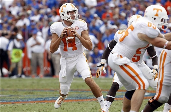 Sep 21, 2013; Gainesville, FL, USA; Tennessee Volunteers quarterback Justin Worley (14) drops back during the second half against the Florida Gators at Ben Hill Griffin Stadium. Florida Gators defeated the Tennessee Volunteers 31-17. Mandatory Credit: Kim Klement-USA TODAY Sports