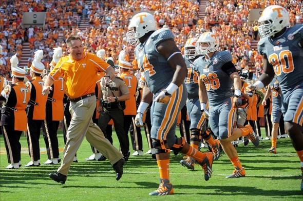 Oct 5, 2013; Knoxville, TN, USA; Tennessee Volunteers head coach Butch Jones leads his team on the field before the game against the Georgia Bulldogs before the first quarter at Neyland Stadium. Mandatory Credit: Randy Sartin-USA TODAY Sports