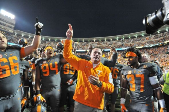 Oct 10, 2015; Knoxville, TN, USA; Tennessee Volunteers head coach Butch Jones waves to fans as he celebrates with his team after defeating the Georgia Bulldogs during the second half at Neyland Stadium. Tennessee won 38-31. Mandatory Credit: Jim Brown-USA TODAY Sports