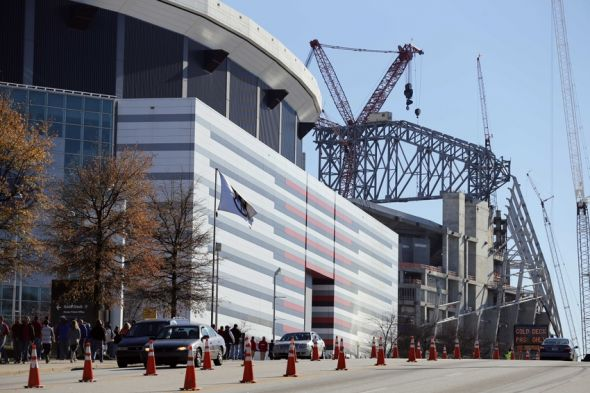 Dec 5, 2015; Atlanta, GA, USA; General view of construction of the Mercedes-Benz Stadium behind the Georgia Dome prior to the 2015 SEC Championship Game between the Alabama Crimson Tide and the Florida Gators. Mandatory Credit: Jason Getz-USA TODAY Sports