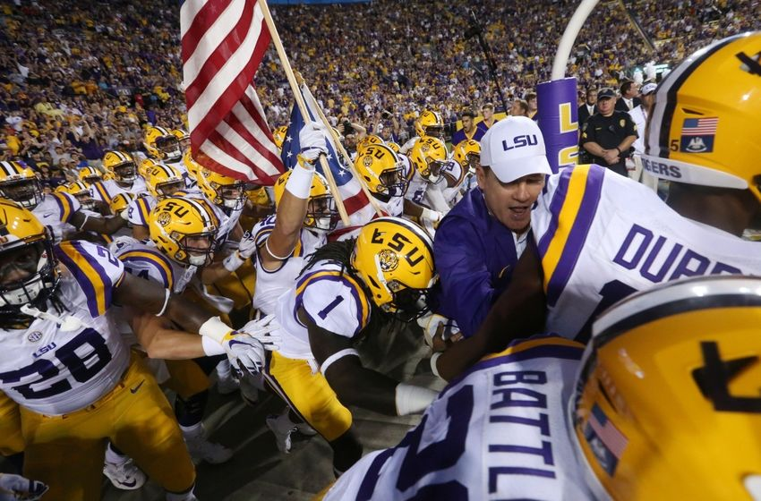 Sep 10, 2016; Baton Rouge, LA, USA;  LSU Tigers head coach Les Miles and the Tigers take the field against the Jacksonville State Gamecocks at Tiger Stadium. LSU defeated Jacksonville State Gamecocks 34-13. Mandatory Credit: Crystal LoGiudice-USA TODAY Sports